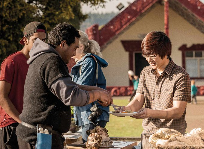 Group serving up a meal embodying manaakitanga or hospitality